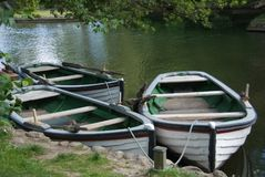 Three old wooden rowing boats for hire Stock Photography