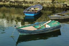 Old wooden boats on a pier royalty free stock photography