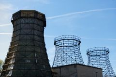 Three old wooden and steel cooling tower. Old wooden and steel cooling towers of coking plant on the grounds of the Zeche Zollverein with sun and blue sky stock photo
