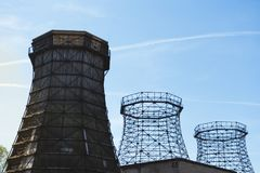 Three old wooden and steel cooling tower. Old wooden and steel cooling towers of coking plant on the grounds of the Zeche Zollverein with sun and blue sky stock photography