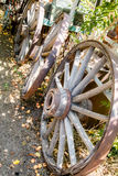 Three old wooden wagon wheels from the old days. Royalty Free Stock Photo