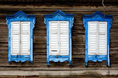 Three old wooden window. Russian traditional style Stock Image