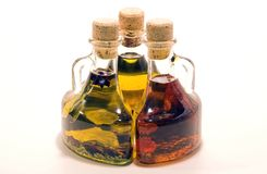 Three olive oil bottles. Set against a white background Royalty Free Stock Photo