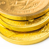 Three one ounce golden coins. Ounce krugerrand, maple leaf and buffalo in gold Royalty Free Stock Photos