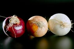 Three onion colors Royalty Free Stock Photography