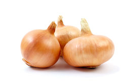 Three onions. Isolated on the white background Royalty Free Stock Photography