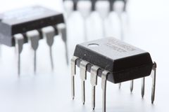 Three op-amps on white. Three DIP-8 format op-amp (operational amplifiers) integrated circuits, on a white background stock photography