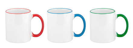Three opaque color mugs isolated on white Stock Photos