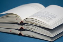 Three open books. Isolated on blue background Royalty Free Stock Photography
