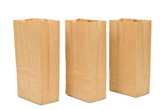 Three Open Brown Paper Sacks With Shadows stock image