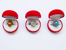 Opened round red jewelry boxes  on white background Stock Photos