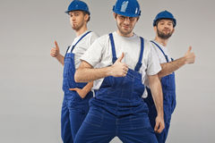 Three optimistic employees during the work Stock Photos