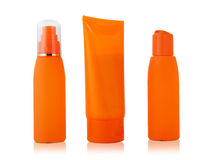 Three orange container suntan isolated on white background Stock Images