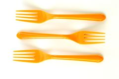 Three orange forks Stock Photos