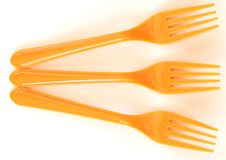 Three orange forks Stock Images