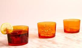 Three orange glasses stock photos
