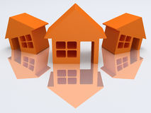 Three orange houses with reflection. 3d render. Stock Images