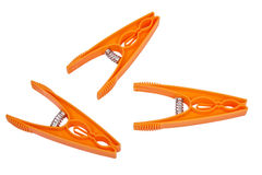 Three orange pegs Royalty Free Stock Photography