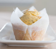 Three Orange and Poppy Seed Muffins. Stock Photography