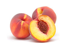 Three orange red peaches  on a white background. Royalty Free Stock Photo