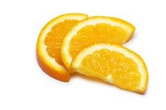 Three orange slices isolated Royalty Free Stock Photo