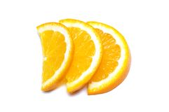 Three orange slices isolated. On the white Stock Images