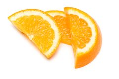 Three orange slices isolated. On the white Royalty Free Stock Photo