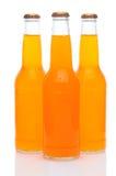 Three Orange Soda Bottles on White Royalty Free Stock Images