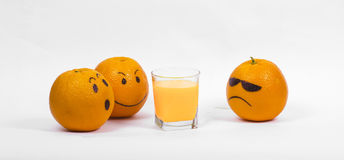 Three oranges. And a glass of juice Stock Image
