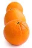 Three oranges arranged on white Royalty Free Stock Photo