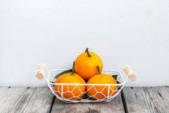 Three Oranges in Basket Stock Photos