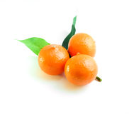 Three oranges and green leaf Stock Photo