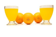Three oranges and orange juice Stock Photo