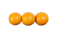 Three oranges in a row. Stock Photos