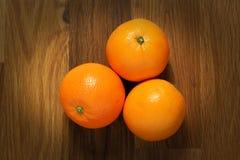Three oranges Stock Photos