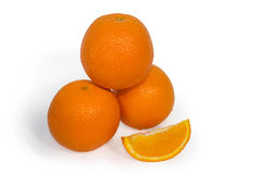 Three oranges and slice isolated Royalty Free Stock Image