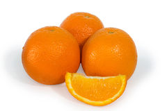 Three oranges and slice isolated Royalty Free Stock Photos