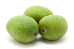 Three Organic green Indian Mangoes. Royalty Free Stock Image