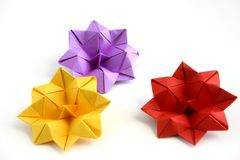 Three origami lotus flowers. Small origami flowers made from regular paper Stock Photography