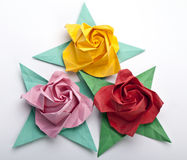 Three origami roses. Flowers, a white background stock photo