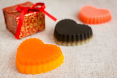 Three original handmade soaps shaped like hearts. stock images