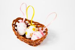 Three Ornate eggshells with ribbons in nest - easter decoration royalty free stock photo
