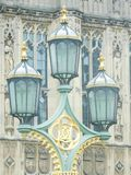Three Ornate Lanterns. Beautiful and very old ornate aqua tinted glass and metal lanterns with gilt details in London, England stock photography