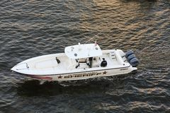 Three Outboards on Sheriffs Boat stock image