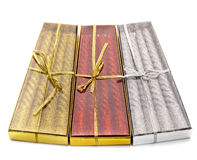 Three packs of Christmas candles red, silver and gold Royalty Free Stock Photography