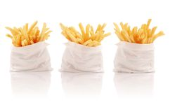 Three packs of french fries. Three isolated packs of french fries Royalty Free Stock Photo