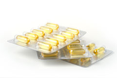 Three packs of gel capsules in blister Royalty Free Stock Image