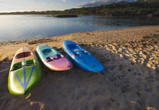 Three paddle boats or paddle skis on the beach Stock Photos