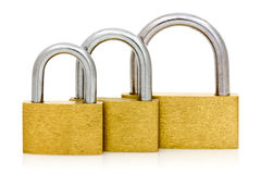 Three padlocks of different size in a row Royalty Free Stock Images