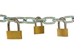 Three padlocks hung on metal chain Royalty Free Stock Photos